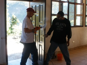 Eddie and Ron installing door hardware