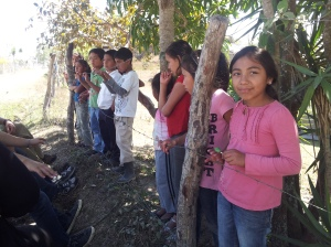 Children hearing the story of Jesus on the side of the road in Rancho Obispo from the February team.